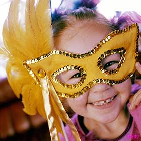 little-girl-wearing-mardi-gras-mask-280x2801